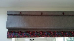 Roman blind with piped, shaped border in Liberty's Marky B Tana Lawn
