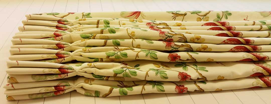 lined and interlined, pinch pleated curtains which are pleated to the pattern of the fabric are one of our specialities